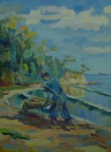 Remus z taczką nad brzegiem morza